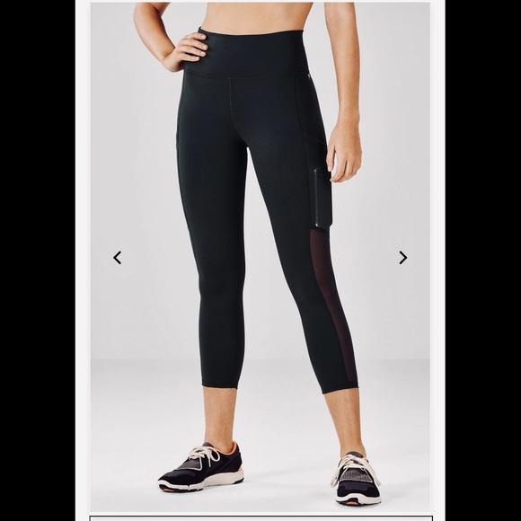 83ed5751ebfe3 Fabletics Black Mila Pocket Capri leggings. Fabletics.  M_5c2aab6dc61777e81696b28d. M_5c2aab6e035cf1f9e511abcd.  M_5c2aab7004e33d26064ed84f